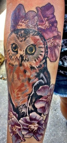 fyeahtattoos.com done by Nate @ Inflicting Beauty. Florida. 27July12 my beautiful owl :) my mom and i decided to get our third matching tattoo. this one is mine, her's is the same but with pink flowers on the top. it's one of my absolute favorite out of the 8 tattoo's that i have. rachyy89.tumblr.com :)