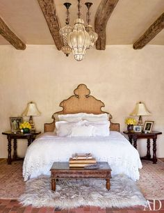 The actress designed the headboard in the master bedroom; the bed linens are vintage, and the ceiling fixtures are Italian.