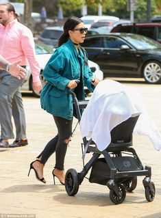 Family-friendly outing: Kim brought along baby Saint, five months, to the child-friendly gathering at Nobu