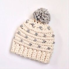 Stay cozy with this free crochet beanie pattern. Knit look stitches, chunky yarn, and a playful pom pom are what make this beanie a family favorite.