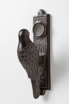 I am always looking for new and interesting accents. I like this woodpecker door knocker!