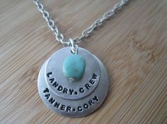 Personalized baby necklace with middle names and room for both boy and girl.