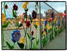 Love this yarn-bombed fence.