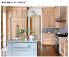 """Just what I was looking for...blue and wood combination of cabinets in a kitchen. These are cerise white oak. Countertops are marble, and on the island, quartzite. Backsplash in Ann Sachs. Floor is engineered white oak. """"Kitchen of the Month"""" in the March 2015 issue of House Beautiful."""