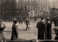 A Manchester City Police officer gives directions to a member of the public amidst the crowds on Market Street in 1910.  Market Street, one of the most famous old thoroughfares in the city was changed almost beyond recognition by the development of the Manchester Arndale Centre in the 1970s.   Parts of the street saw further change when the area was redeveloped after the IRA bombing of 1996.  Though much changed, Market Street remains at the heart of modern Manchester…