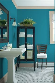 Look at the paint color combination I created with Benjamin Moore. Via @benjamin_moore. Wall: Avalon Teal CSP-645; Trim: Greenwich Gate CSP-170; Chair: Brownstone CSP-240.