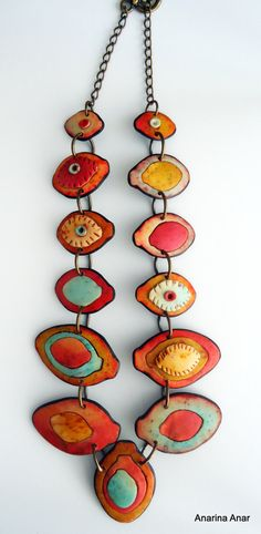 This is one of my favorite jewelry artists - her use of color is delightful.
