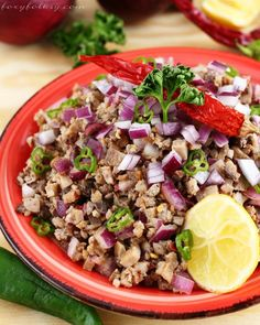 Pork Sisig - A popular Filipino dish originating from Pampanga. A true Kapampangan delicacy from simple ingredients.| www.foxyfolksy.com
