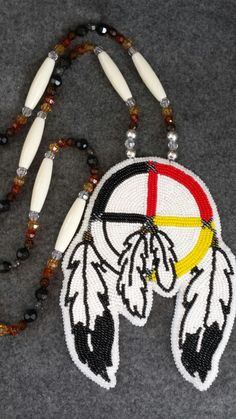 Medicine wheel with feathers beadwork                                                                                                                                                                                 More