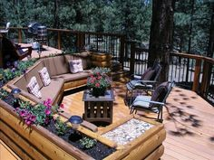 A perfect deck w/built-in seating area to enjoy views of forest, stream, hot tub