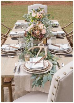 Chic, rustic wedding reception inspiration with farm table, pheasant feathers and antler details designed by Invision Events, florals by Thorne & Thistle, image by Heather Durham.