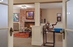 Lower level rec room with brick fireplace. Denny Blaine estate, Seattle, WA
