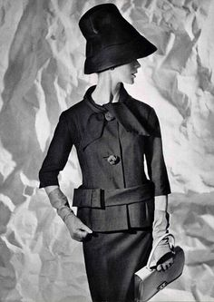 Silk shantung suit with three-quarter sleeves and a charming belted bow at the waist by Pierre Cardin, handbag by Hermès, 1960