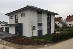 Stadtvilla in Steinheim - modern, Passivhaus, Anthrazit abgesetzt.
