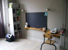 Add a plain black chalkboard and a wood shelf with wood brackets under board - like old-school.