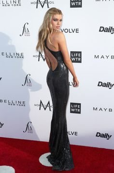 Updos Lookbook: Stella Maxwell wearing Half Up Half Down (3 of 3). Stella Maxwell went for some boho charm with this half-up wavy 'do at the Fashion Los Angeles Awards.