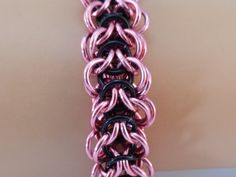 Show off your wrist this season with this beautiful and unique chainmaille bracelet. This bracelet is woven into a pattern I call Spinal Elf,. Spinal Elf is a variation of the traditional Elf Weave that I invented when experimenting with the pattern. Made of Anodized Aluminum wire the