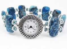 "bracelet watch made with beautiful blue crazy lace agate stones, 3mm faceted blue crystal glass and silver tone spacers. A very special, substantial feeling piece of jewelry.    This watch measures about 7 1/4"" and will comfortably fit a wrist measuring about 6 1/2 "" to 7"". It is strung on super strong 1mm Stretch Magic Cord"
