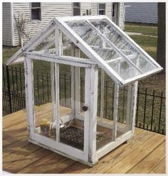 urban homestead recycling project using windows. This small greenhouse could be a cute decorative feature, or quite functional, and could be sized to just about any dimension your reclaimed windows will allow. Greenhouse Film, Cheap Greenhouse, Backyard Greenhouse, Greenhouse Wedding, Greenhouse Plans, Greenhouse Effect, Old Window Greenhouse, Pallet Greenhouse, Homemade Greenhouse