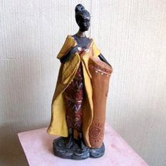 Yesos y ziñas Covarrubias, fabricante de figuras desde 1965. Statue, Pretty, Crafts, Image, African Dolls, Paper Mache, Plastering, Black Art, African Women
