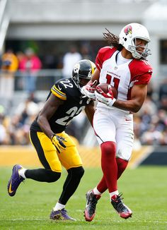 Larry Fitzgerald #11 of the Arizona Cardinals carries the ball past William Gay #22 of the Pittsburgh Steelers during the 1st half of the game at Heinz Field on October 18, 2015 in Pittsburgh, Pennsylvania. (Oct. 17, 2015 - Source: Jared Wickerham/Getty Images North America)