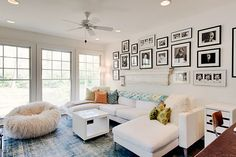 Love the wall of photos over low couch