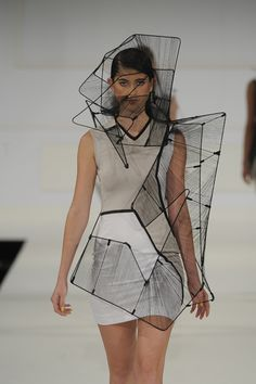 Designer: Richard Sun 3D Fashion architecture, wearable sculptural design.  I like the idea of the bodycon dress being contrasted with colour and shape with the overlay of the 3D manipulated thinned fabric. It seems to be made with a vary of techniques such as 3D printing, pleated fabric, tulle, and silk organza.