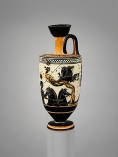 Terracotta lekythos (oil flask)  Attributed to the Sappho Painter     Period:      Archaic  Date:      ca. 500 B.C.  Culture:      Greek, Attic  Medium:      Terracotta