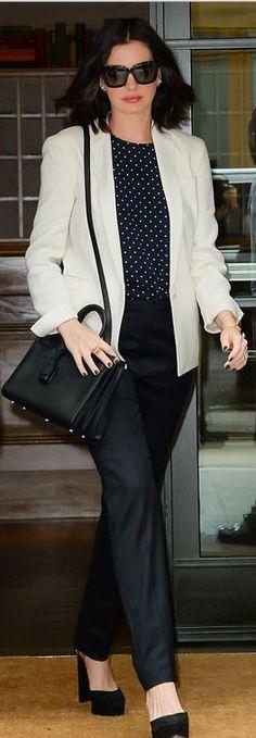 Anne Hathaway: Purse – Saint Laurent  Shirt – Zimmermann  Blazer – Akris  Sunglasses – Michael Kors