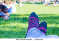 closeup of colored #socks of a teenager who is #resting in a #park #microstockita