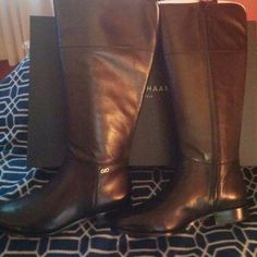 Cole Haan Primrose Riding Boot wide calf Brand new, never worn, still in box, is the Cole Haan wide calf Primrose Riding boot. Beautiful black leather boot is complete with a full inside zip opening, and a small Cole Haan emblem at the outside bottom of boot. Circumference is 16 inches. Cole Haan Shoes