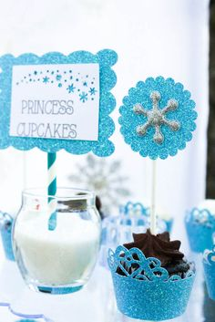 Love these snowflake cupcake toppers from this Frozen themed birthday party with SUCH CUTE IDEAS via Kara's Party Ideas | Cake, decor, cupcakes, games and more! KarasPartyIdeas.com #froze...