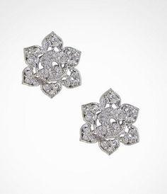 LARGE PAVE FLOWER POST EARRINGS at Express.  Lets skip the clothes and pile on some serious jewelry instead.