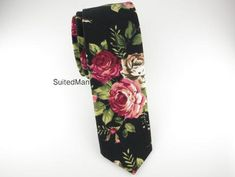 Treat yourself to a floral arrangement with one of our floral ties. Dimensions: 2 inches at greatest width.
