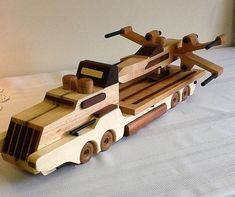 WE ALSO SHIP INTERNATIONALLY. Star Wars Semi & Fighter Plane made of poplar, cedar, black walnut, pine and maple. Made by Ron Reininger in the USA. Any variation in wood should not be considered as flaws but rather the beauty of Mother Nature. Wooden Toy Cars, Wooden Truck, Wood Toys, Wood Projects, Woodworking Projects, Woodworking Kids, Wood Games, Handmade Wooden Toys, Toy Art