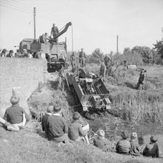 A Universal carrier of 53rd Division being hauled out of a
