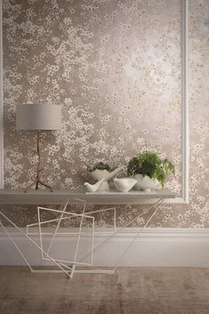 Pretty wallpaper design featuring paint effect florals, on a distressed plaster effect background, with a lustre finish.