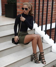 Olive shoes and leather mini skirt with black sweater.