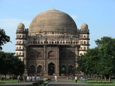 "Gol Gumbaz, Bijapur, Karnataka  This tomb was completed in 1656 by the architect Yaqut of Dabul. Although ""impressively simple in design"", it is the ""structural triumph of Deccan architecture"" and has the distinction of having the second largest dome in the world."