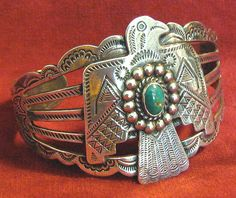 Beautifully stamped Navajo silver bracelet with thunderbird and turquoise stone