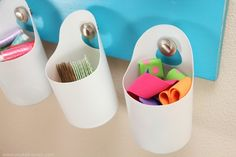 These hanging storage bins are made from baby wipes containers, but they could be made with any tall, round container...coffee creamer, bleach, etc.  They can also be covered with colored duct tape or painted to match the area around them.  These would be great drink holders if you find a way to hang them on the deck or chair rail.