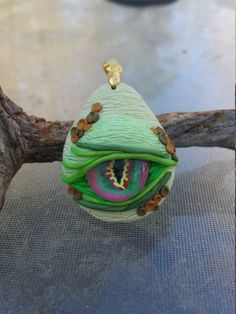 Dragon Eye Pendant - Greens and Golds by TNTPatterns on Etsy