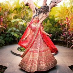 Even though we have seen a lot of brides moving from the colour red to offbeat colours for their bridal attire but let us admit that the colour red on brides makes our heart skip a beat! Red is the colour most associated with brides...Don't believe me? Shut your eyes and think of a bride...What is she wearing? A red lehenga, right! (See, I told ya). So, coming back to today's blog also which happens to be the last blog of the year 2016, we have rounded up our favourite brides who wore...