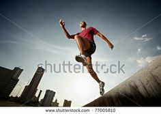 stock photo : Latin american athlete running in Havana, Cuba. Horizontal shape, full length, low angle view