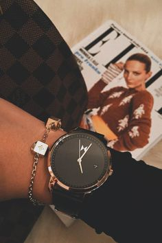 The Women Rose Gold/Black Leather MVMT watch