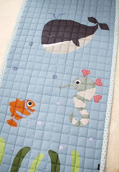 100% handmade. (made in Korea)    It is a comfy mat or pad which has the concept of sea decorating a whale, sea horse, and fish.    The size can be