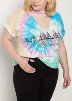 Rock out in this hot graphic tee! Made of cotton jersey in an allover tie-dye print, it features screen print Def Leppard graphics and a choker neckline.