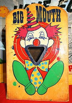 BEAN BAG CLOWN TOSS - Paint a large cardboard box to look like a clown face. Cut out the eyes, nose and mouth making wide holes; set the box in the middle of the party room. Give the party guests beanbags or balls to try to throw through the holes on the clown face.