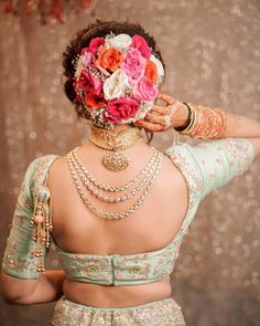Looking for Big bridal bun with roses? Browse of latest bridal photos, lehenga & jewelry designs, decor ideas, etc. on WedMeGood Gallery. Bridal Hairstyle Indian Wedding, Bridal Hair Buns, Bridal Hairdo, Indian Wedding Hairstyles, Indian Bridal Makeup, Bride Hairstyles, Bridal Photoshoot, Hairstyle Ideas, Wedding Bun