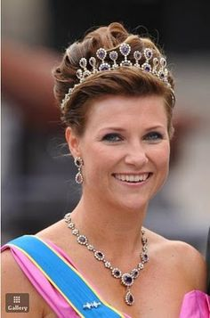 Princess Martha Louise of Norway is wearing a gorgeous amethyst Tiara that was a gift to her mother, Queen Sonja, and she has paired them with amethyst necklace and drops to match.